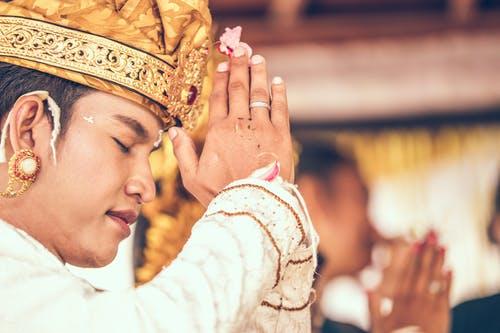 Indonesian man prayer marga bali